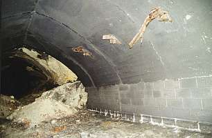 """One damaged tunnel of Kellerbau I with concreted roof on February 24, 2001 (Source: GMC publication """"St. Georgen-Gusen-Mauthausen – Concentration Camp Mauthausen Reconsidered"""")"""