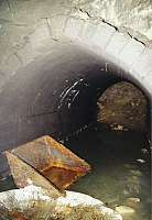 """One tunnel of Kellerbau III with granite roof on February 24, 2001 (Source: GMC publication """"St. Georgen-Gusen-Mauthausen – Concentration Camp Mauthausen Reconsidered"""")"""